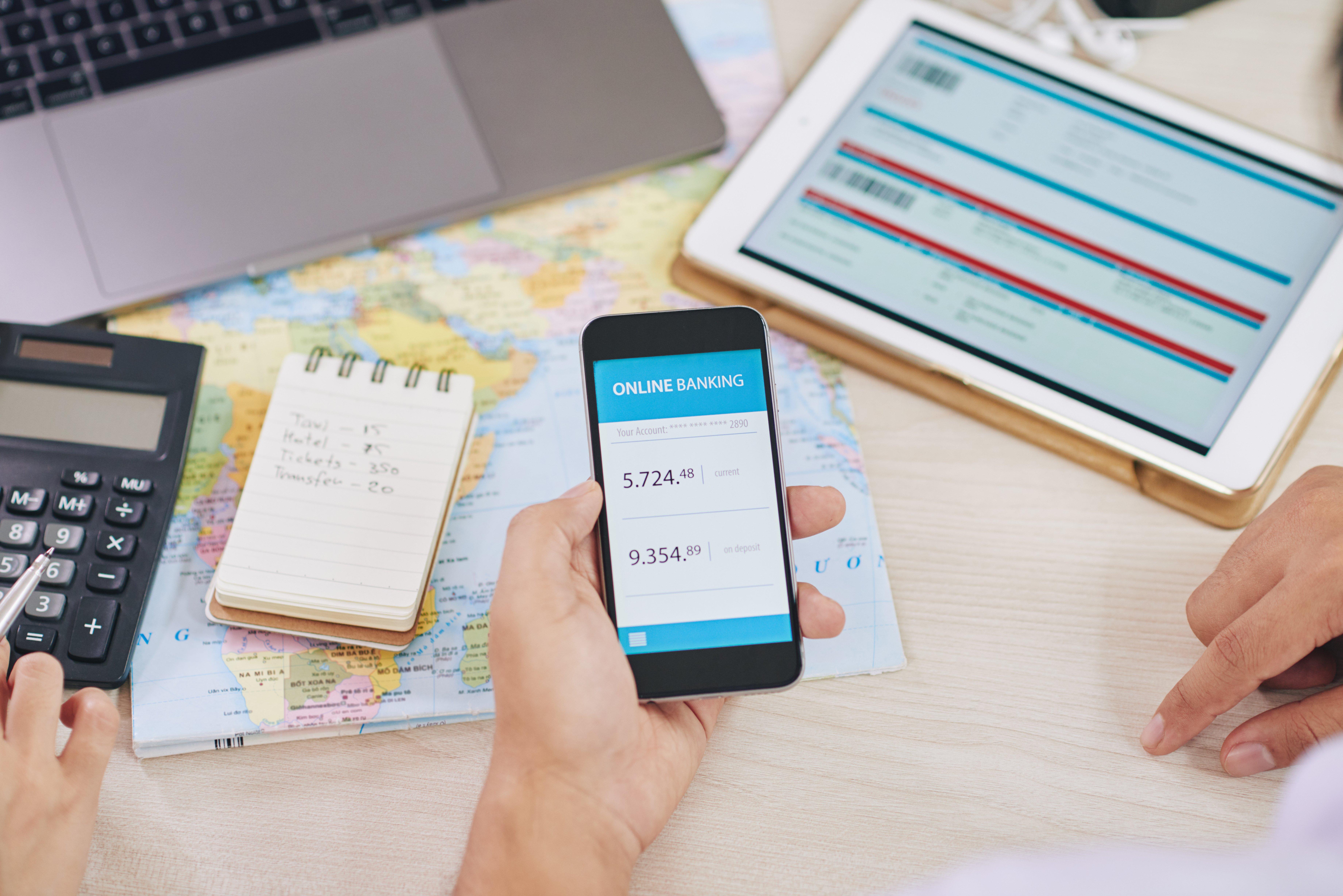 crop-people-using-gadget-with-online-bank-app-UEFB5TU